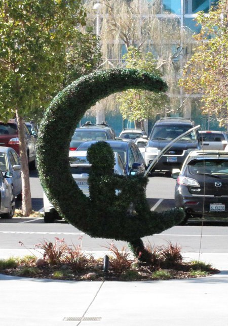 A bush transformed into the DreamWorks logo outside the building.