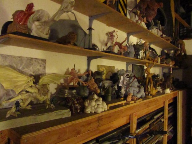 Shelves display creature models from numerous feature films.