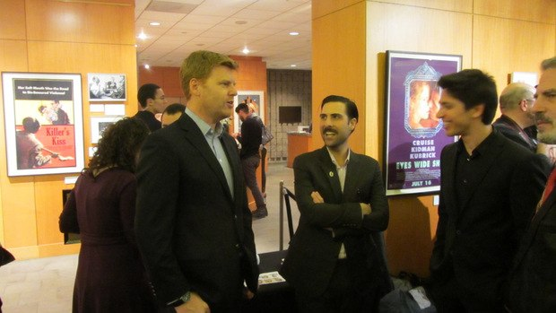 John Kahrs (left) speaks to host and moderator Jason Schwartzman (middle) at the reception.
