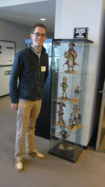 Tim at the Ray Harryhausen Theatre beside a display case