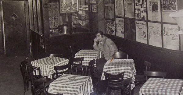 Photograph of Ralph at Sammy's Bowery Follies during a location scout. Actual background used in Fritz the Cat where the revolutionary Crows sat.