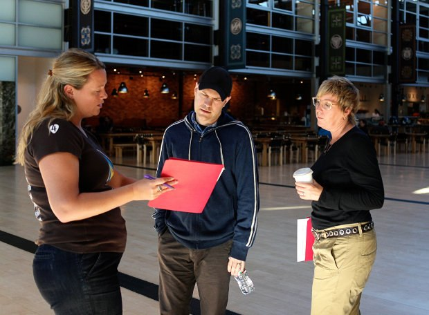 Director Dan Scanlon (center) having a quick drive-by meeting with Script Supervisor Amanda Jones (left) and Kori (right) in the atrium at Pixar.