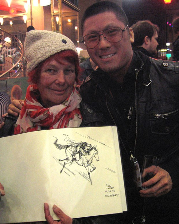 Jonathan Ng showing Nancy his drawing for her memory book.