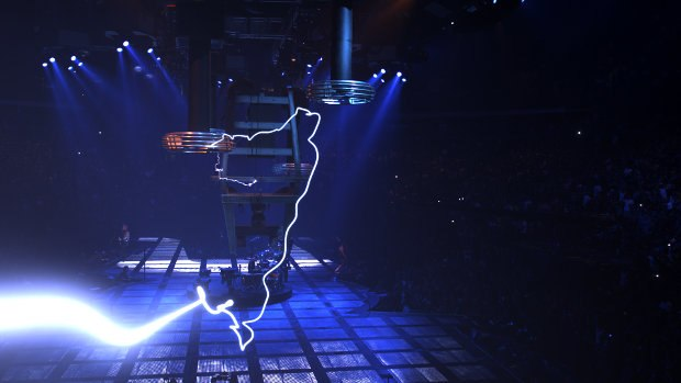 Lighting shoots out of one of the onset Tesla Coils.