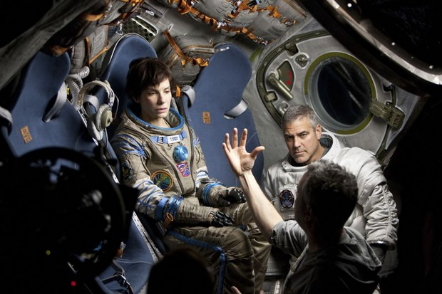 Sandra Bullock, George Clooney and director Alfonso Cuaron on the set of Gravity. Click on any image to see a high-res version. All images (C) 2013 Warner Bros. Entertainment Inc.