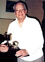 Maurice Noble with his awards from ASIFA-Hollywood and the Motion Picture Screen Cartoonists Union. February, 1998. Photo © 1998 Animation World Network.