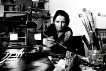 Kirsten Winter at work, using oil paints to transform photographs into art for her animated films. © Kirsten Winter.