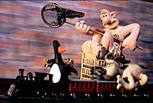 In The Wrong Trousers' train chase scene, animators moved the wall in the background to create a realistic motion blur. © Aardman.