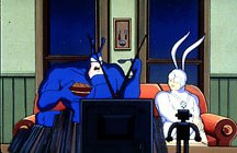The Tick and his sidekick Arthur watching TV. From the animated series, The Tick. © Fox Children's Network.