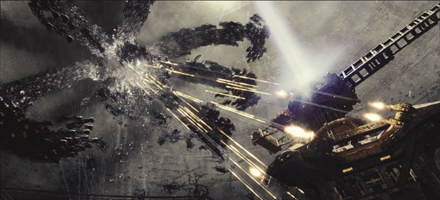 ESCs work on the trilogy set new vfx standards. Here the Sentinels retreat as the Zion crane tower attacks with gunfire in Matrix Revolutions. Courtesy of ESC Entertainment.