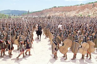 Troys crowd scenes were a real challenge to MPC, which had to develop its own simulation software for the project. Here Greek warriors greet Achilles (Brad Pitt). Courtesy of Warner Bros. Ent. © 2004 Warner Bros. Ent. All rights res
