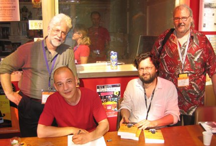 AWN Press launched its first book, The Animation Pimp, at Annecy with a book signing (seated left to right) by illustrator Andreas Hykade and author Chris Robinson with co-publishers (standing, left to right) Ron Diamond and Dan Sarto.
