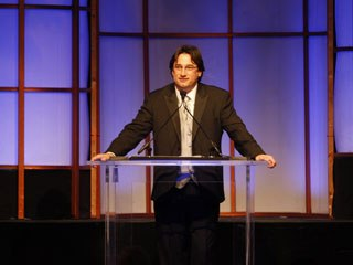Jeff Barnes' plate is full these days. His ComputerCafe Group encompasses The Syndicate, CafeFX and Sententia Ent., plus he's the new chairman of the VES. Here he speaks at the last VES awards. © Spelling Communications.