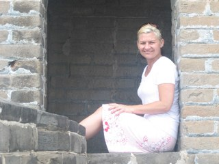 eather Kenyon lounging on the Great Wall of China.