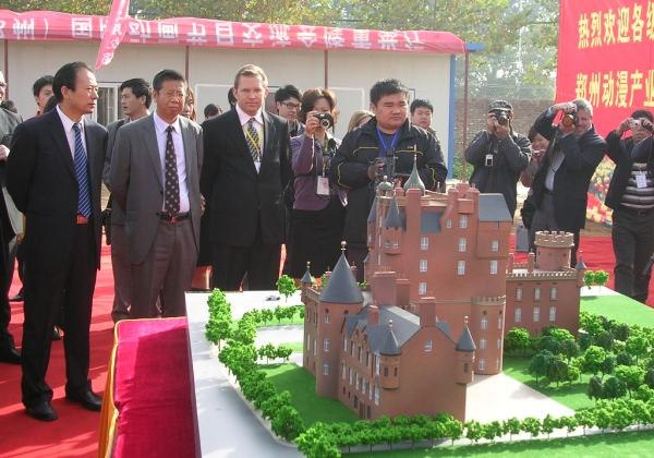 Kevin Geiger and local government officials look at model of planned Zhengzhou Animation Base, scheduled for completion in 2 years.