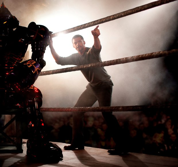 REAL STEEL director SHAWN LEVY and star HUGH JACKMAN discuss a scene on set at Crash Palace. Photograph by Greg Williams ©DreamWorks II Distribution Co., LLC.