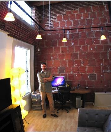 Motion Graphics Artist Brian Simpson in his suite at Intake Studio's new Kansas City satellite company