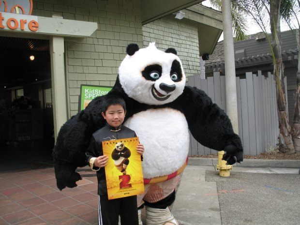 Perry Chen with Po from Kung Fu Panda 2 at the San Diego Zoo (photo by Zhu Shen)