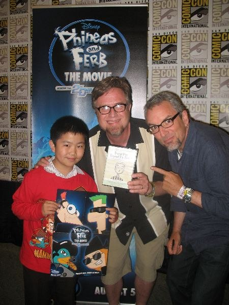 "Perry Chen with Jeff ""Swampy"" Marsh (R) & Dan Povenmire (M, holding my animation film DVD), creators of Phineas & Ferb at Comic-Con 2011 (photo by Zhu Shen)"