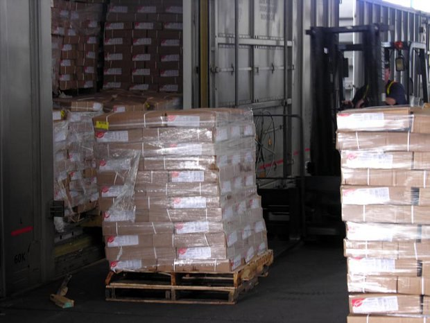 Palettes of Mars Needs Moms DVDs are moved back into warehouse containers after the foiled robbery attempt.