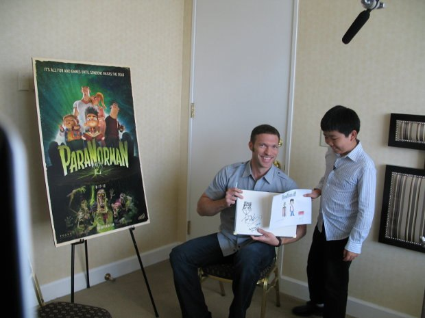 Perry Chen and Travis Knight showing off their ParaNorman drawings.