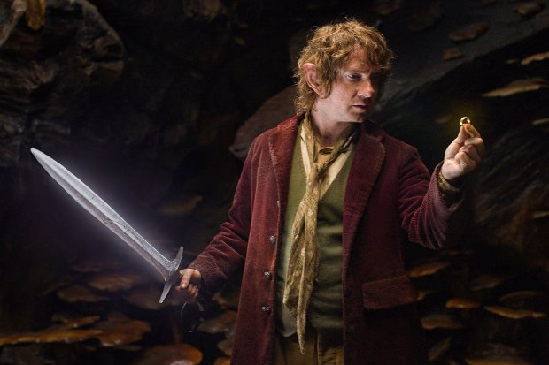 "Bilbo Baggins, his sword Sting, as he examines ""the ring."" All images courtesy of Warner Bros. Pictures."