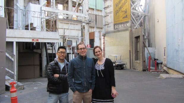 Minkyu, Tim and Fondhla in front of one of the countless generic building fronts used in countless shows and commercials.
