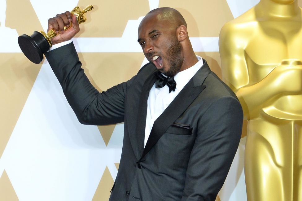 247d9753cc81 Retired NBA star Kobe Bryant celebrates his Academy Award win for  Dear  Basketball  backstage at the 2018 Oscars. Image courtesy of AMPAS.
